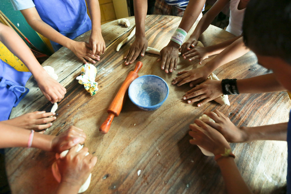 Students at the Asociacion Casa Ave Maria mold dough. Each of the participating students create different breads and pastries which are then baked.  At the end of the day, every student in the program got to eat the product of that days lesson. CREDIT: VICTORIA LODI-