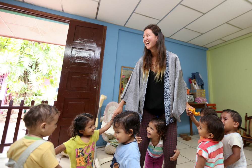 Inyo, a Casa Nica volunteer, looks after children at a local day care facility in Masaya, Nicaragua. Credit: Victoria Lodi
