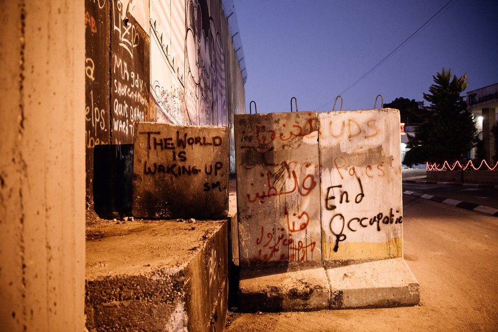 WRITING ON THE WALL THAT SURROUNDS BETHLEHEM IN THE WEST BANK. PHOTO BY MAGGIE SVOBODA