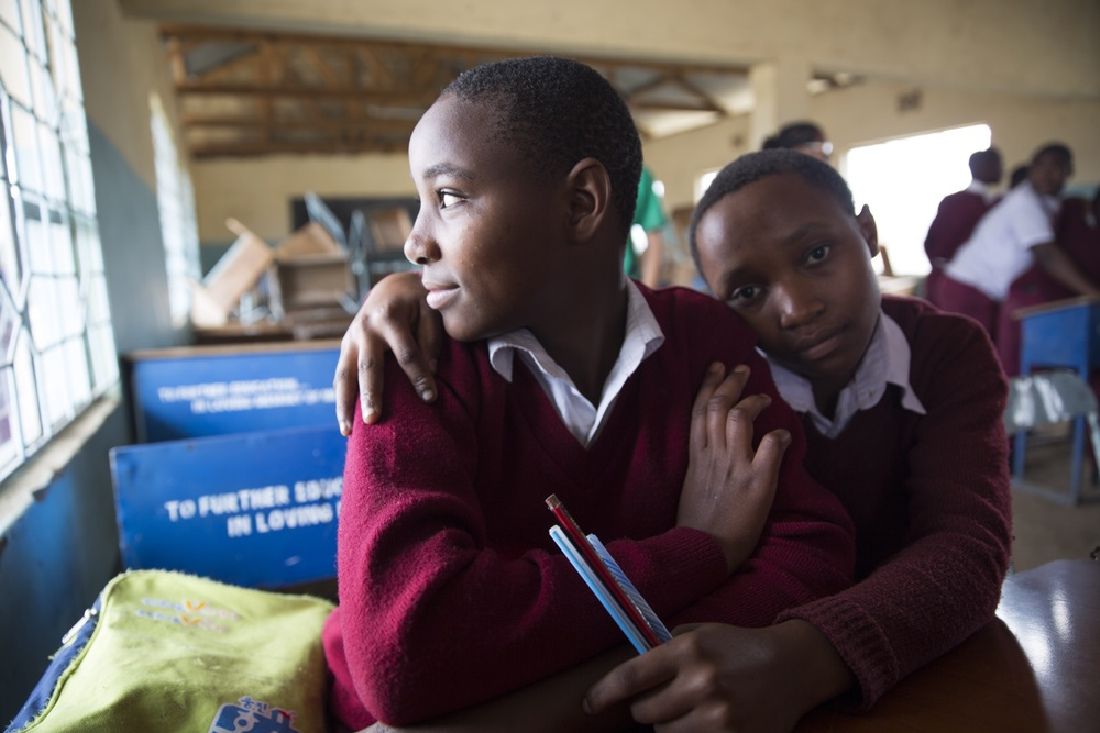 Teenagers spend 9 hours a day from 8 am until 5 pm at Matevesi Secondary School in Arusha, Tanzania, learning everything from English to Chemistry. Photo by Kelly Wenzel