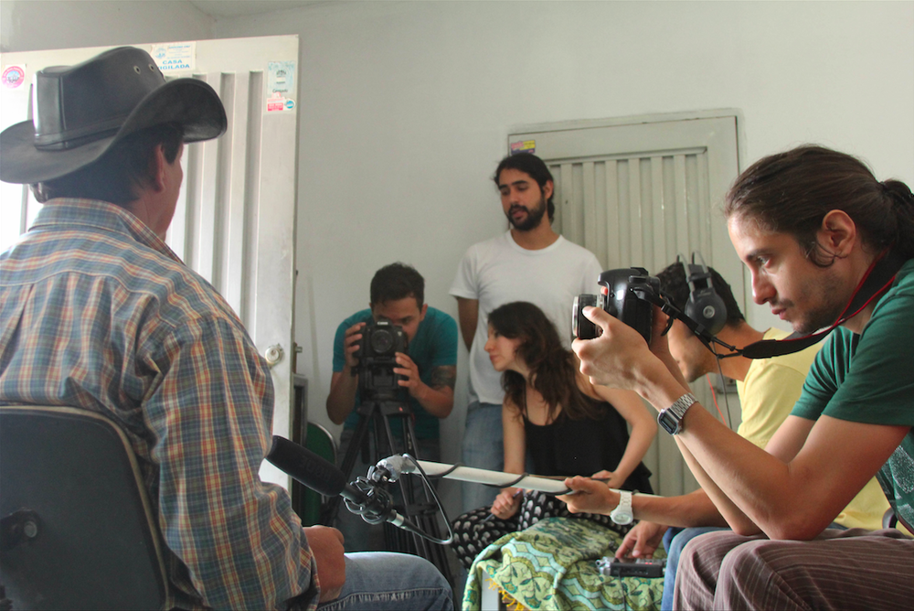 Claudia Quigua is seen on-site with her crew in Cali, Colombia, conducting the interview of the zorrero where she worked as the director and producer of the Global Lives Project. //Photo by Nelson Gomez for Global Lives Project.