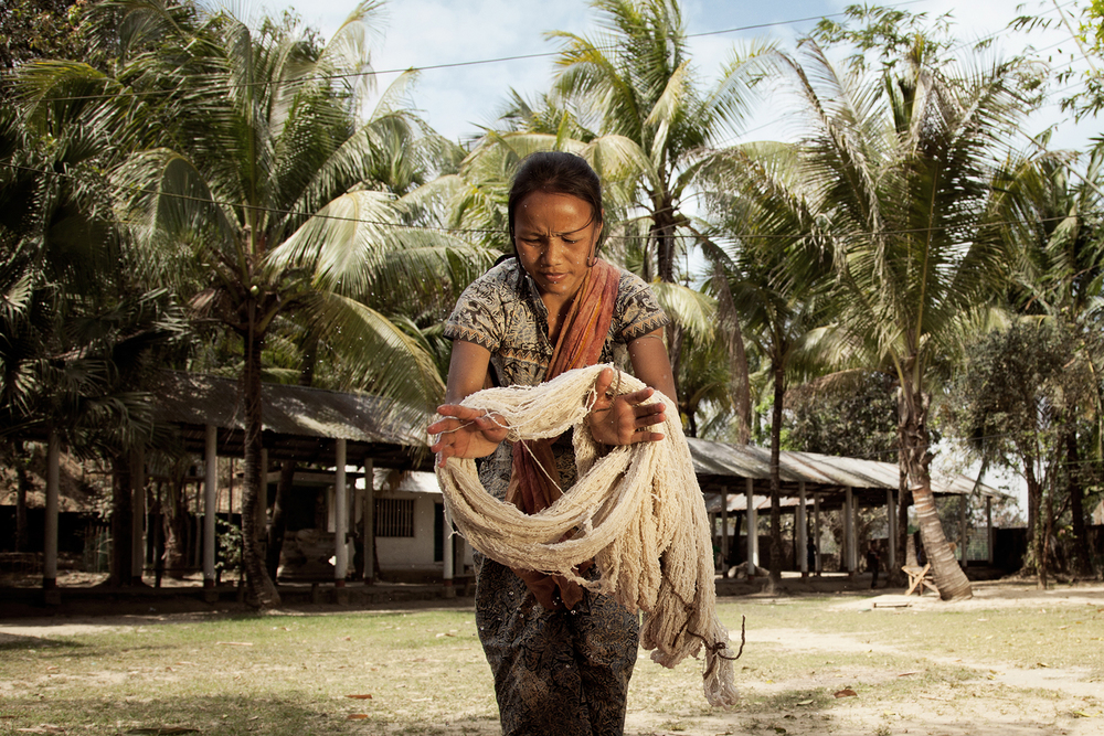 A woman from the Tripura tribe in the Chittagong Hill Tracts in Bangladesh, using natural materials to dye the hand spun cotton. // PHOTO BY:TOBI ANN