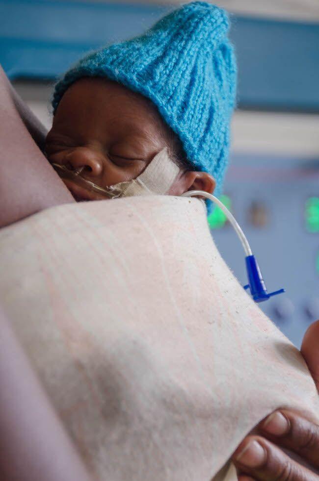 An infant receives care at the Kisiizi Hospital. Photo by: CECILIA GURIDI