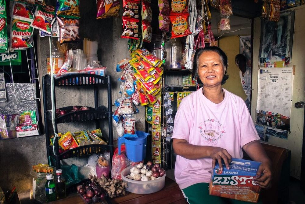 Mely, a resident of Moncada, runs a sari-sari (variety) store. It is a small-scale convenience store that is very common in the rural areas in the Philippines. Mely's store is particularly well-known in the village, because she sells a wide variety of products, from canned goods, to school supplies, to children's toys. PHOTO BY DANIEL IGNACIO.