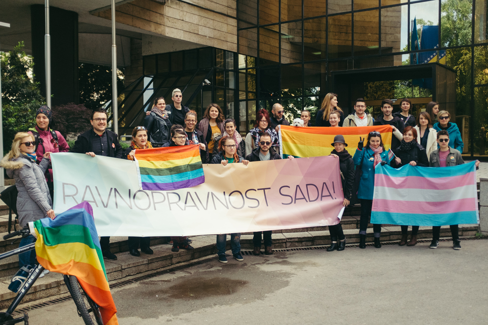"At the end of their designated one-hour protest, the group gathers for a photo op. Their sign, ""RAVNOPRAVNOST SADA!"" is Bosnian for, ""EQUALITY NOW!"" (Mel Hattie/Photographers Without Borders)"