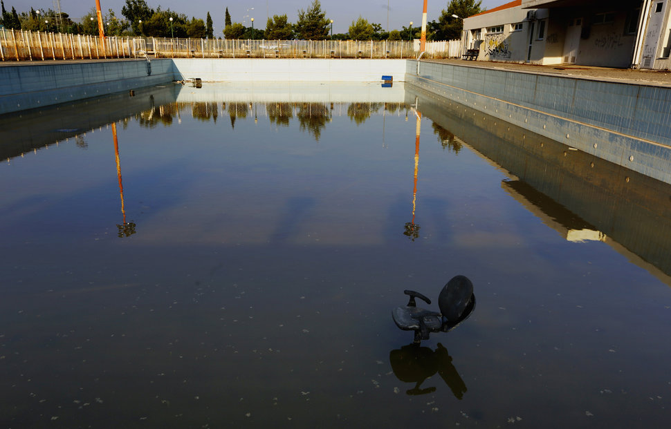 A deserted swimming pool at the Olympic Village in the town of Thrakomakedones, north of Athens,in July 2014. Photo by Yannis Behrakis / Reuters