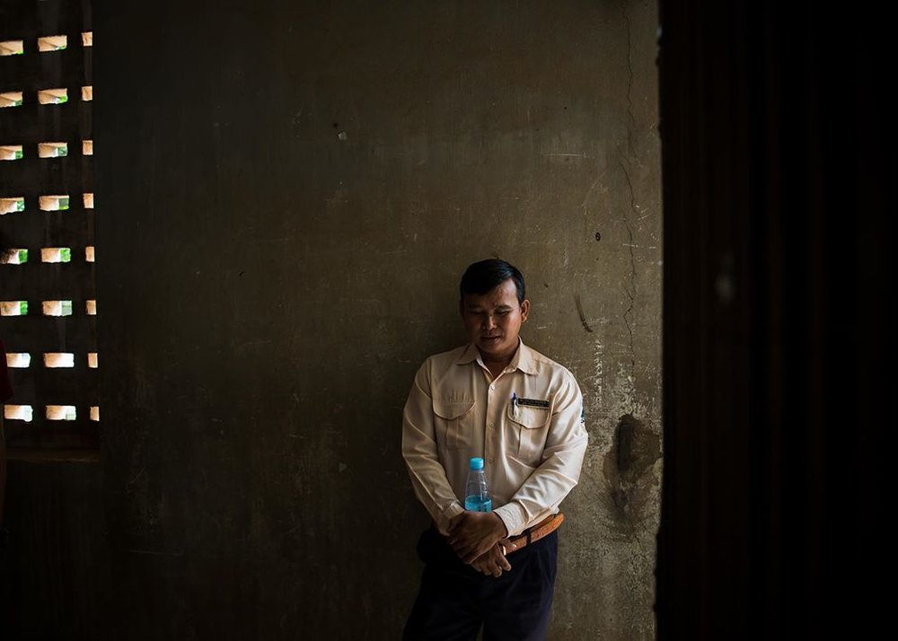 """Mr. Om Chambroeun on his job: """"Some days it's okay; others, it's not."""" PHOTO: Anita Bonnarens"""