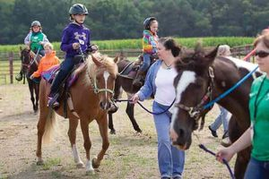 This file photo shows a number of youngsters participating in the first Horses for Healing bereavement camp last year. (File photo by Jerry Sowden)