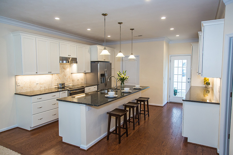 This is a photo of the completed remodel of the same kitchen shown in the above before shot and 3D rendering. What a transformation!