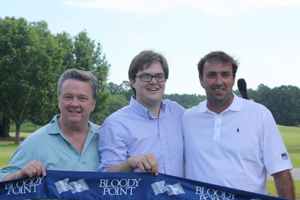 Owners Brian and Kevin McCarthy with General Manager Patrick Ford at the ribbon cutting for the Bloody Point Golf Course
