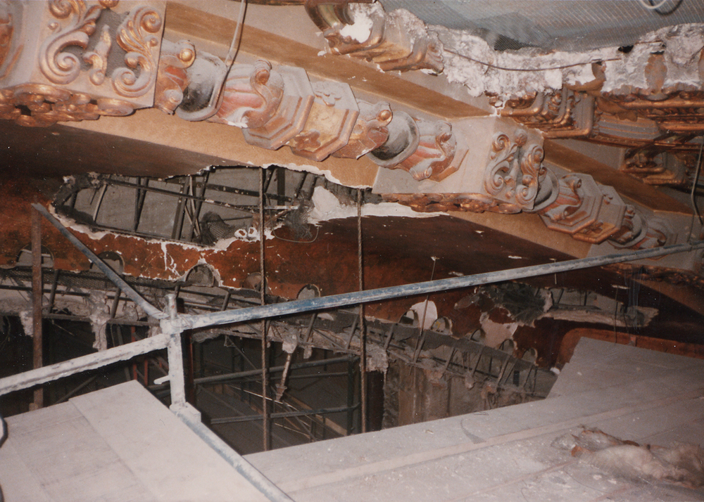 Arch over stage before restoration.jpg