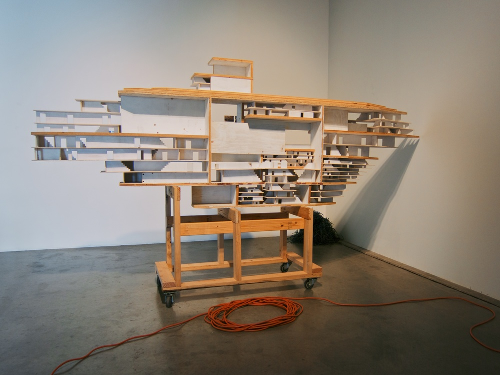 Model ship built from plywood, 2x4s and casters, 10x6x4 feet, 2014.