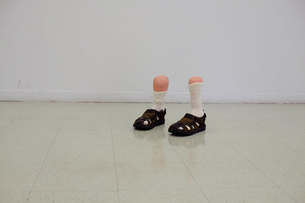 Made at University of Texas at El Paso in Introductory Sculpture, plaster cast feet with socks and sandals, 12x12x18 inches, 2015.