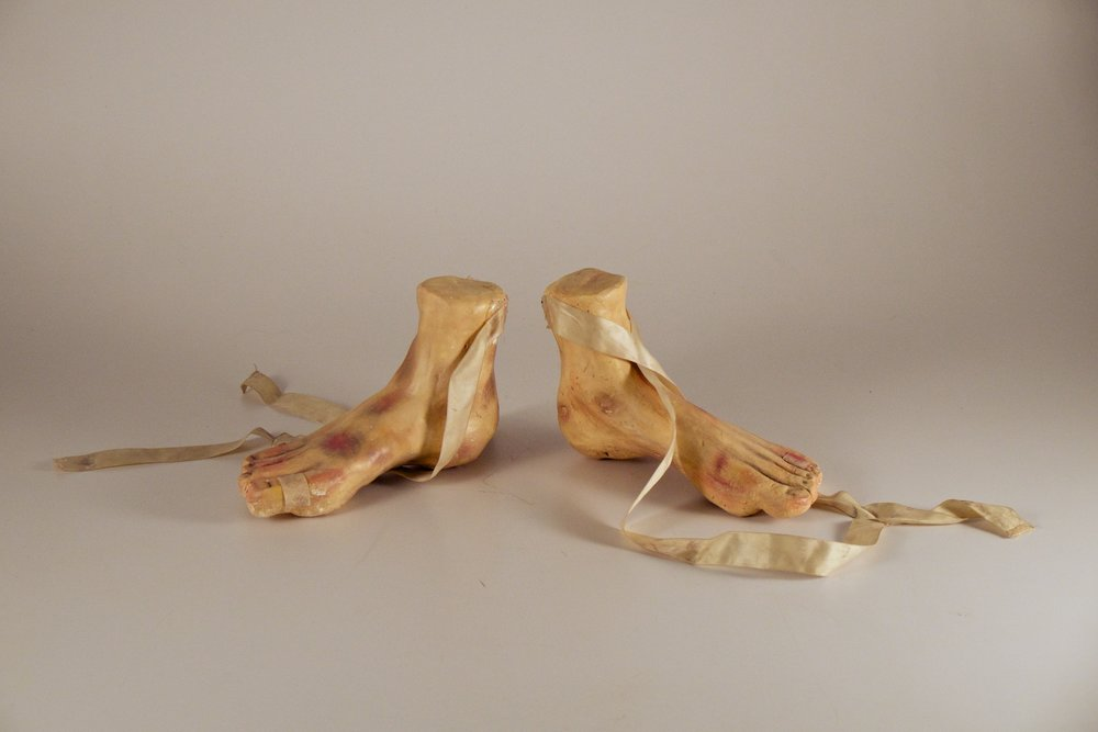 Made at University of Texas at El Paso in Introductory Sculpture, plaster cast feet painted with acrylic paints wrapped with ballet tape, 12x12x18 inches, 2015.