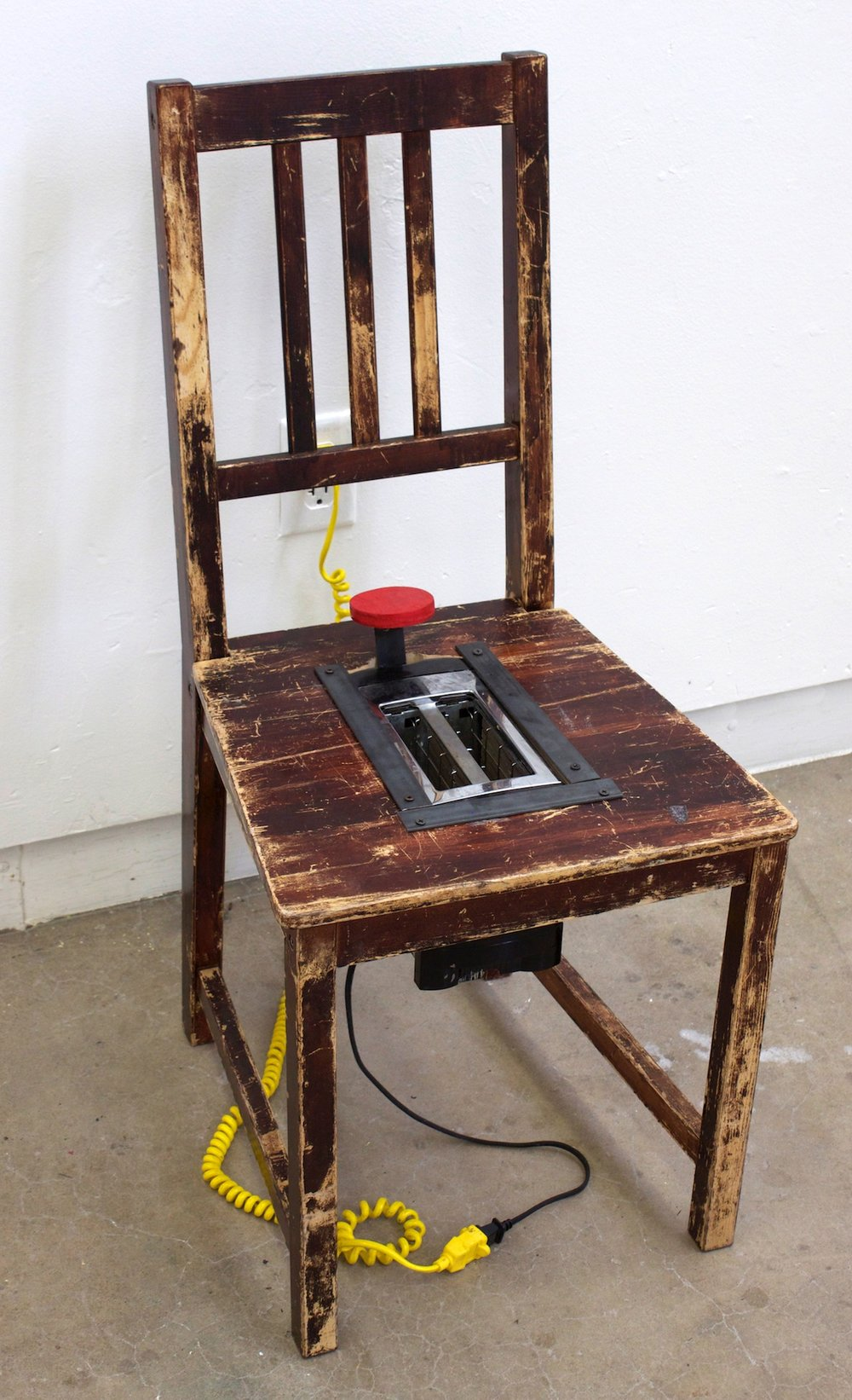 Made at University of Oregon in Wood and Everyday Materials, found chair with toaster embedded in seat, 36x18x18 inches, 2014.