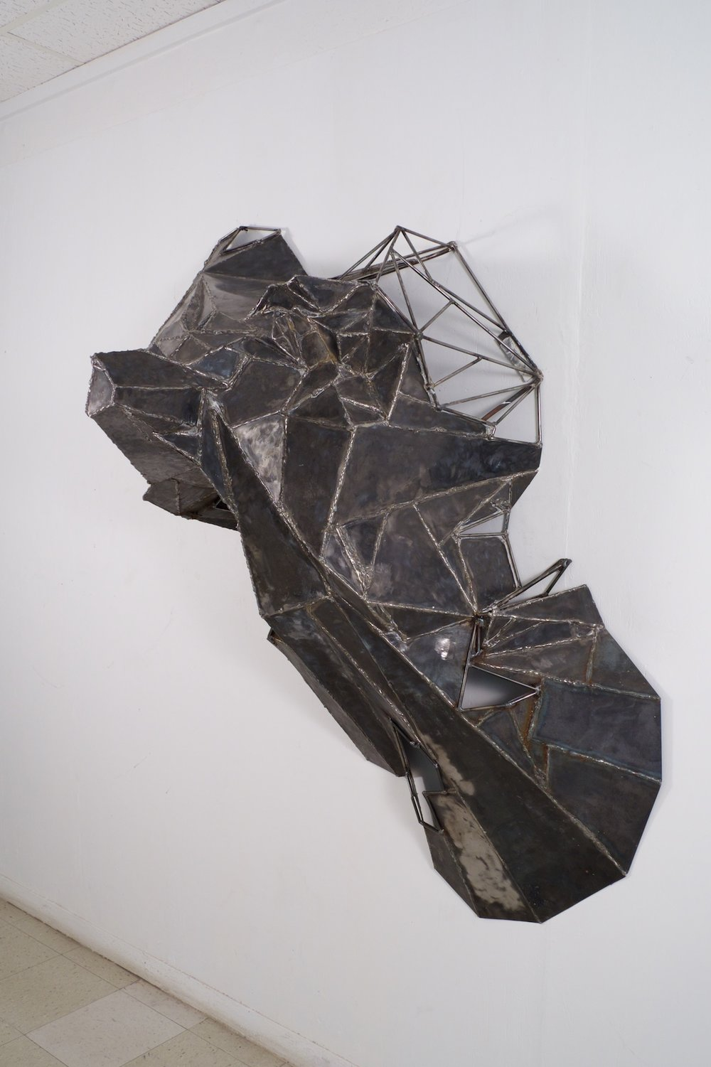 Made at University of Texas at El Paso in Introductory Sculpture, welded steel mountain form, 6x4x3 feet, 2016.