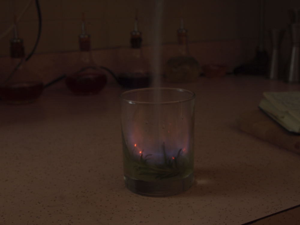 Strain the rest of the drink to extinguish flames.