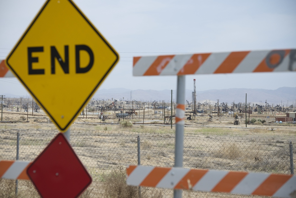 Kern River Oilfield borders residential neighborhood, California.