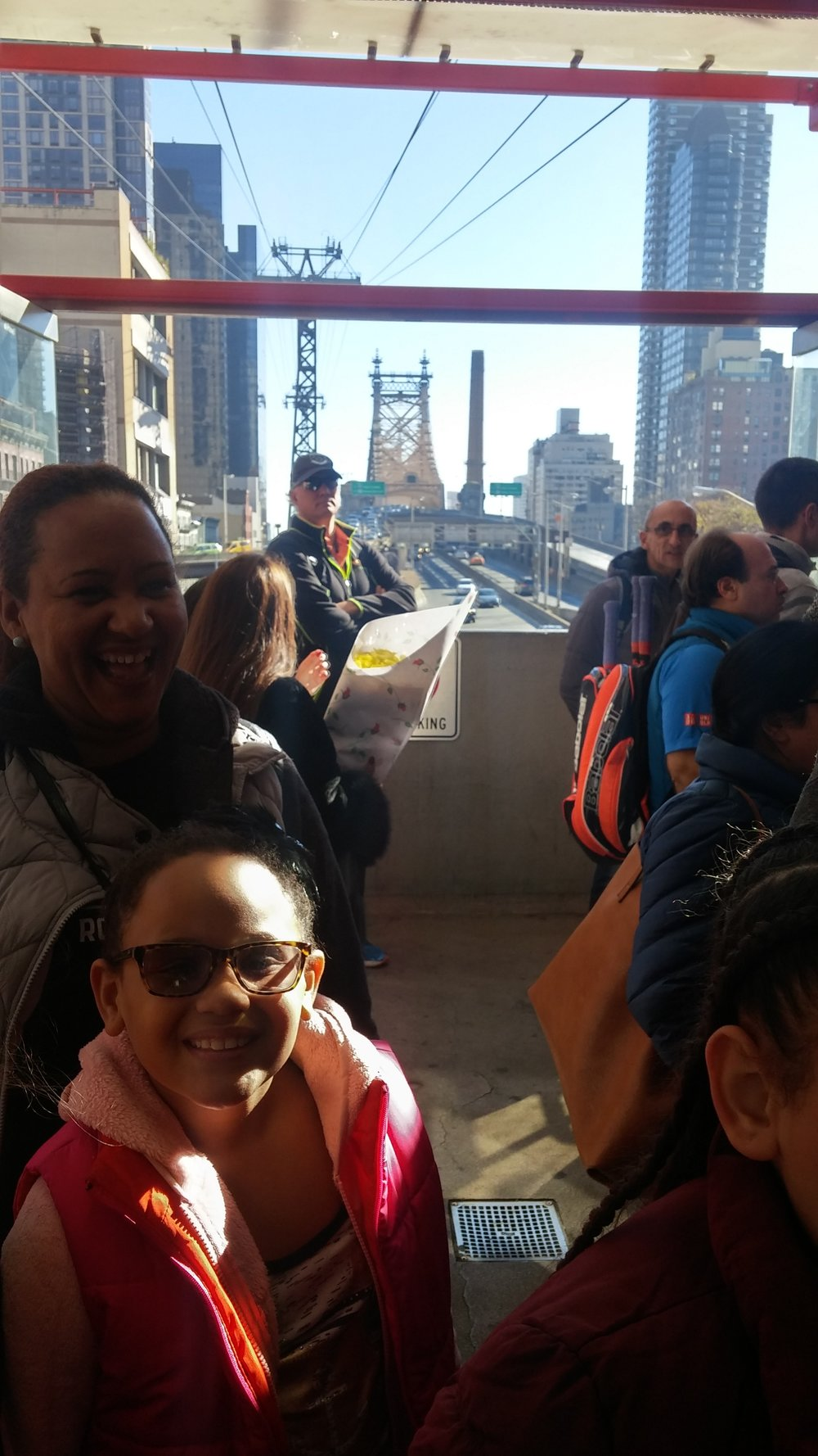 GOAL mom and daughter are all smiles as we cruise above the East River in the Tram.