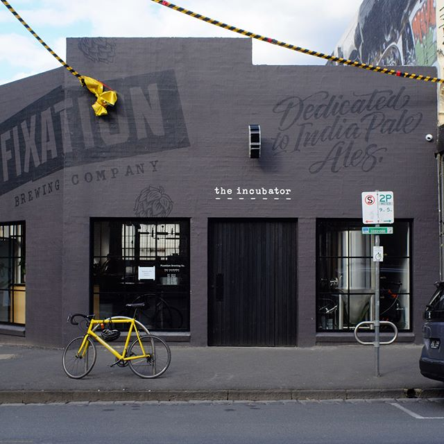 Fixation ✅ On the job a couple days ago with chalk line extraordinaire @signvision_melbourne 🚧 Had a good time pulling this one off freezing on the scissor lift. ❄️Also, how nice does that bike look? ⚡️ @fixationbrewing . . . . . . #signpainting #signwriting #supportyourlocalsignpainter #alwayshandpaint #mural #lettering #letters #paint #melbourne #signs #handpainted