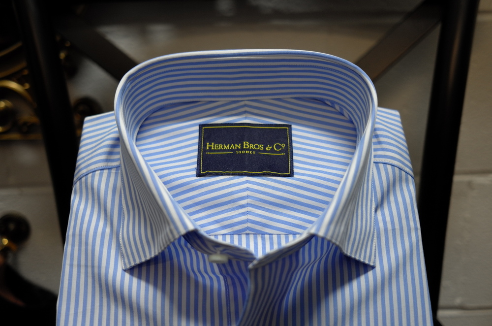Our shirts are made with a traditional split yoke, seen in the two diagonal panels joined in the middle as opposed to one solid piece. Gives stripes shirts a better finish and allows for more stretch in the shirt.