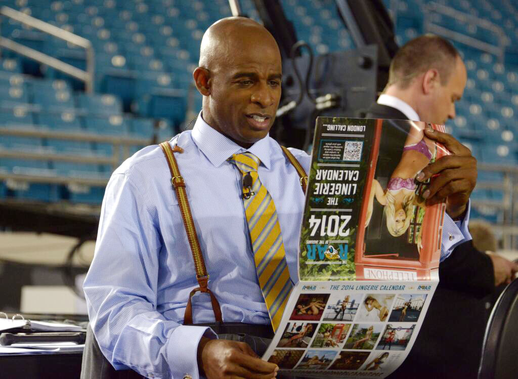 photo: Kirby Lee - USA Today    Thursday Night Football pre-game prep. Deon Sanders checking out our work on the Jaguar Cheerleader calendar.  Get yours and see more  here.