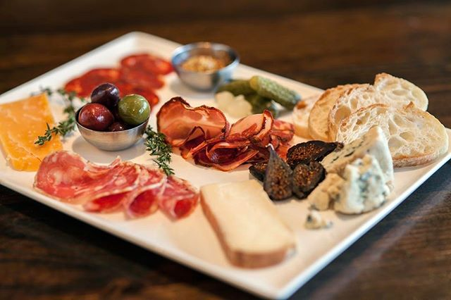 It's Wino Wednesday and we got discounted bottles of wine all night. Nothing goes better with our cheese/charcuterie plate! @timbushwick pouring them for the last time. Arrivederci, signore!