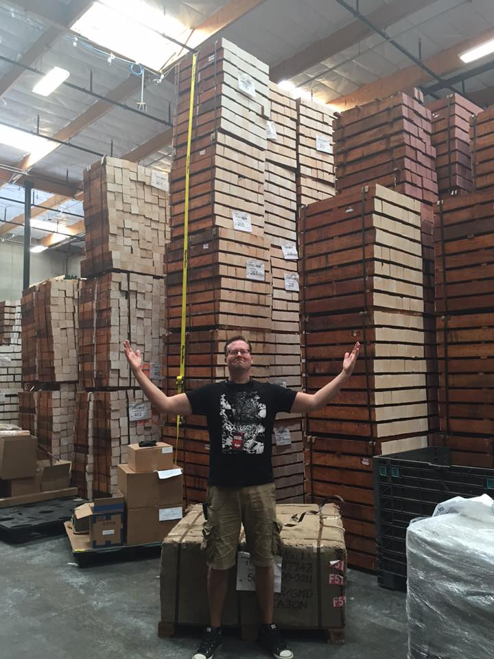 Ben of Nystrom Guitars and a stack of wood. Lots of wood. More wood than the San Fernando Valley