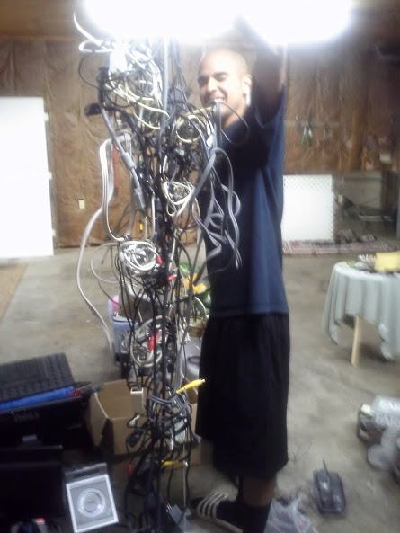 Stephen holding up all of our cords.  We got a lot of those and sold 1 for $0.25.