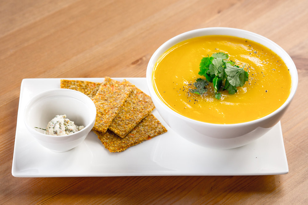 Soupes du Jour   Selection of four cooked soups daily: Coconut Red Lentil, Mushroom & Cilantro, Butternut Velvet, Minestrone.   Served hot with a side of Mamie's Crackers and Dill Nut Cheese.