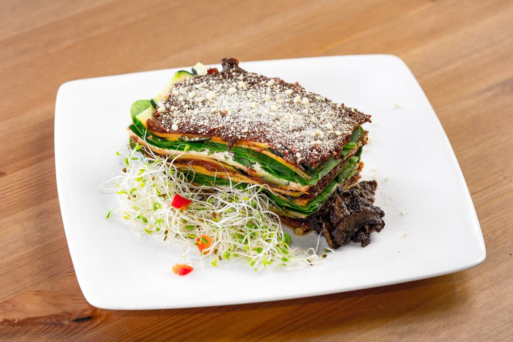 Rawsagna     Layers of zucchini noodles, marinara sauce, nut cheese, spinach, and marinated mushrooms.