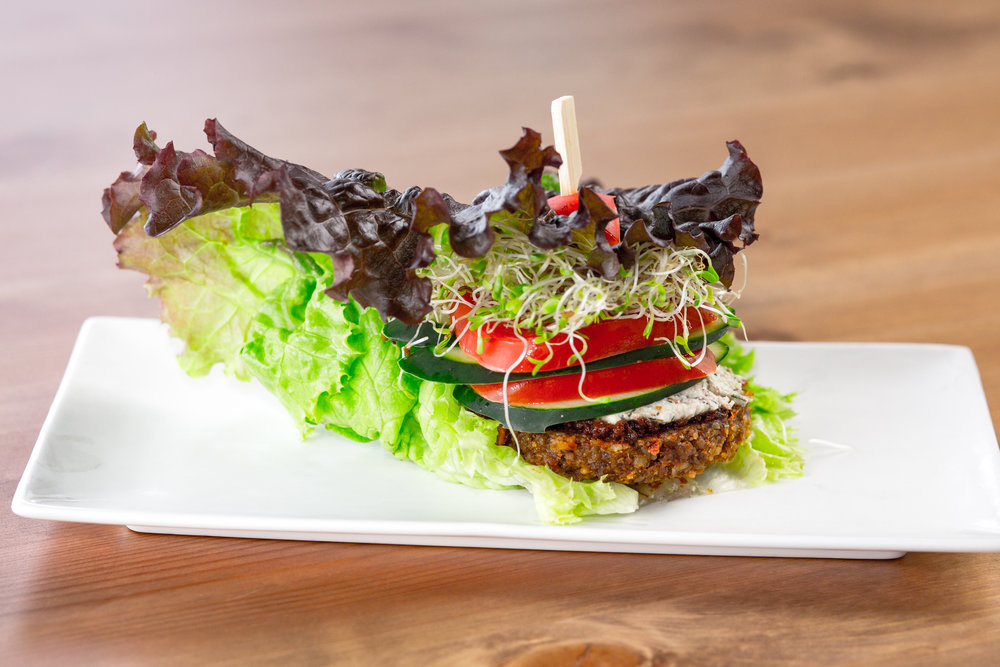 Gaia Burger    Soaked sunflower seeds, walnuts and almond patty. Sweet chili sauce, dill nut cheese, tomato, cucumber, sprouts, wrapped in a lettuce leaf.
