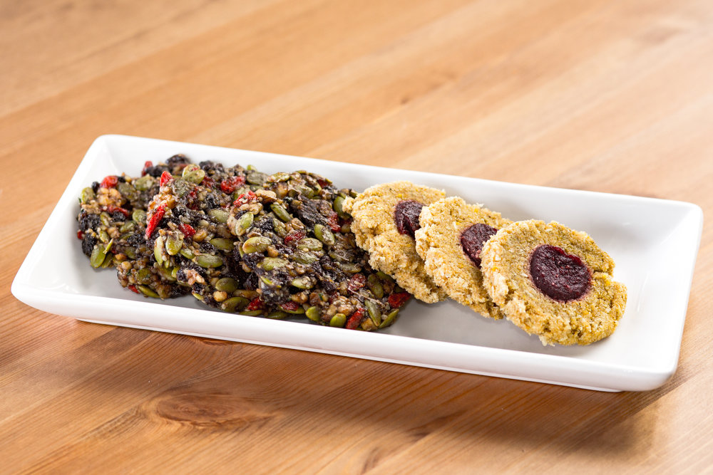 Fruit Fantasie Cookies   Lemon coconut cookies with a burst of fruit flavour in every bite. Raspberry or blueberry.   Bliss Cookies    Sprouted seeds and dried fruit with walnuts, bananas, and dates.
