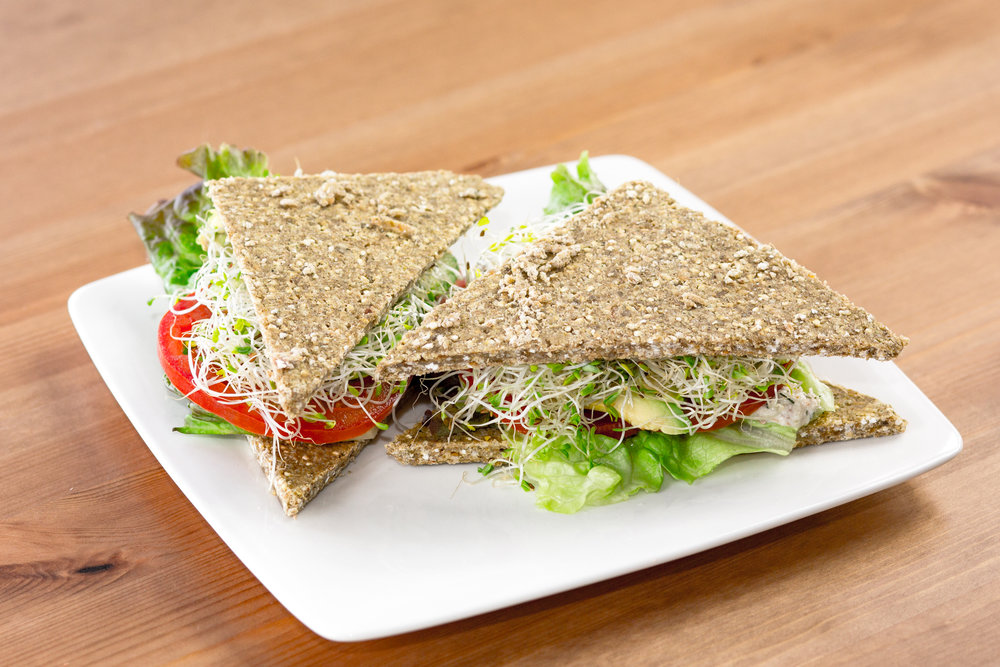 ALT (avocado, lettuce, tomato)   Sprouted buckwheat flatbread with avocado, lettuce, tomato, and alfalfa sprouts. +add dill nut cheese or nut pate +add miso-tahini spread or marinated mushrooms: