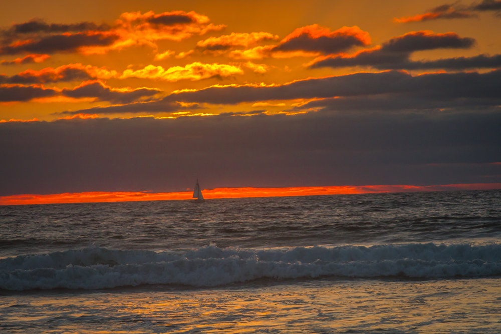 Sailboat at sunset off the coast of southern California