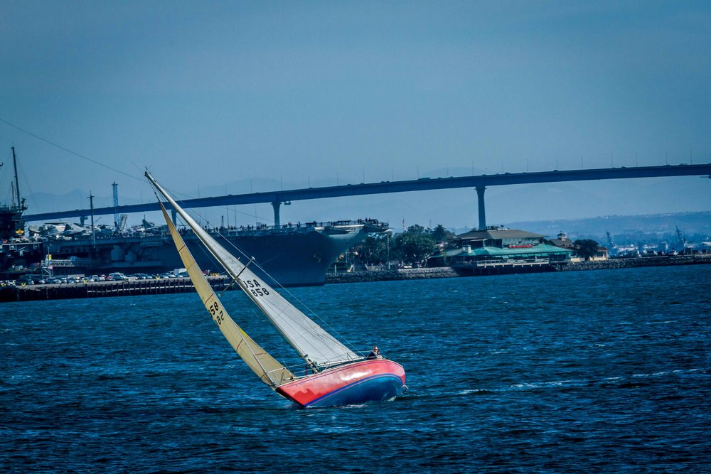 Red Sailboat near Coronado Bridge San Diego, California