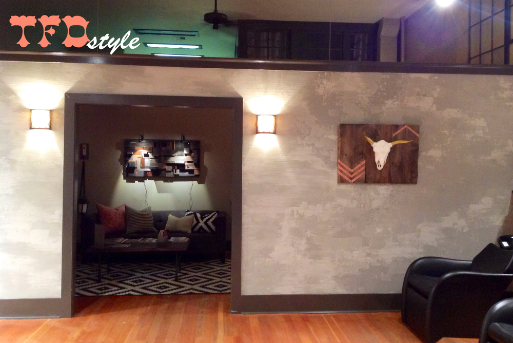 A peak into a redesign for a friend's salon. Textured, faux concrete wall, custom art, DIY industrial coffee table + more!