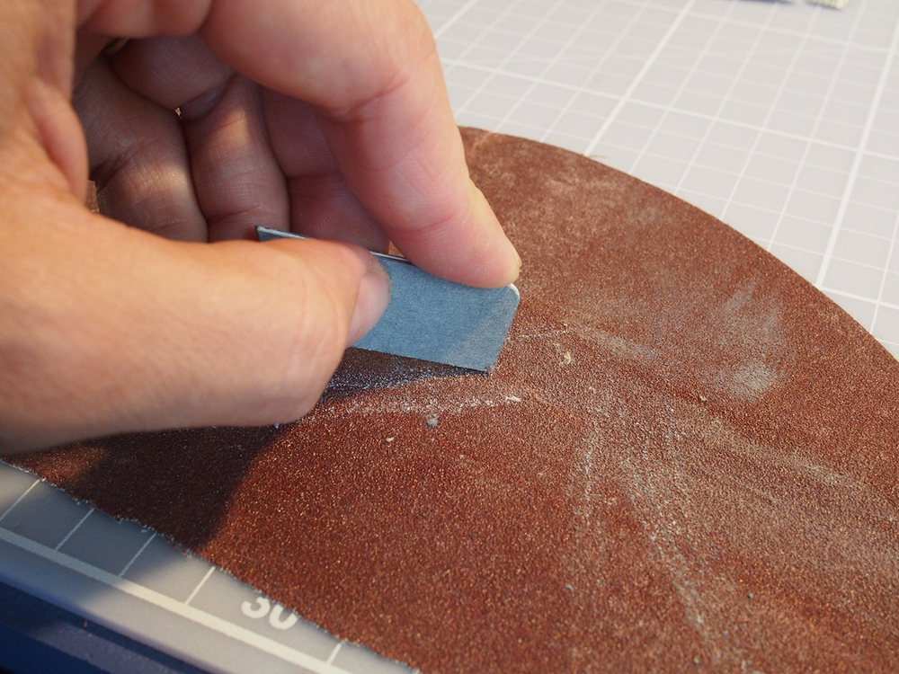 I rounded the edges on some sandpaper—sharp edges would wear down faster.