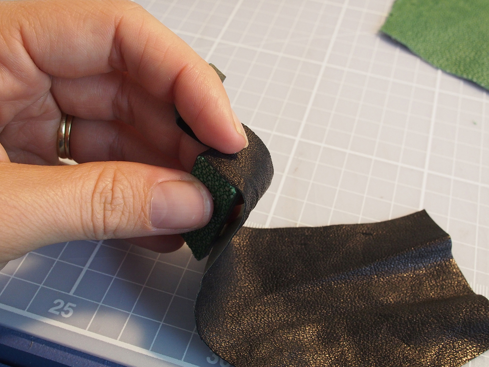 A bit of black skiver wrapping around the edge—I glued then cut in stages, because it was too much of a pain to try to flatten out the leather to cut an exactly even strip. This way it has to be even.