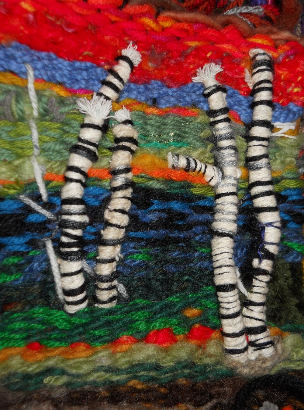 Birch Tree Family Hanging Out By The Water. (c) Kaitha Het Heru. Hand Woven with Assorted Yarns.