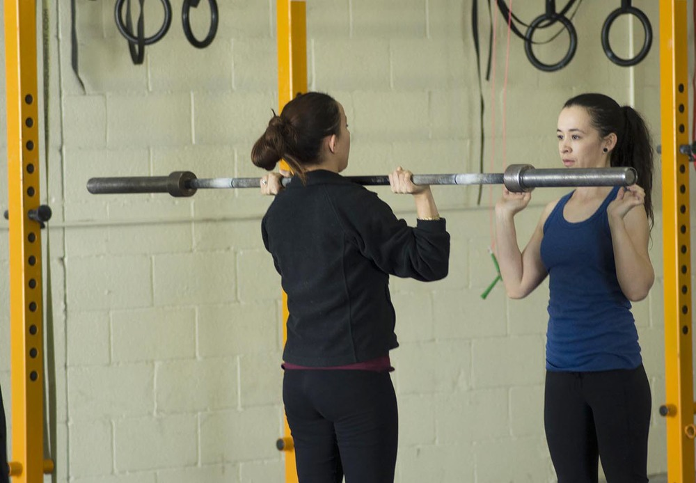 Our athletes help each other grow as they learn new movements and skills.