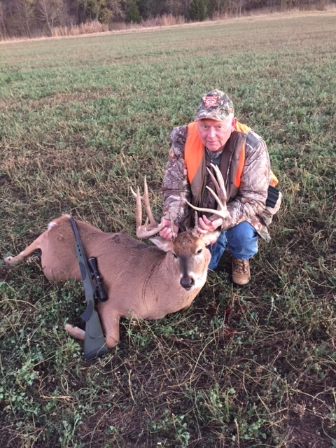 seven o Lew with big buck.JPG