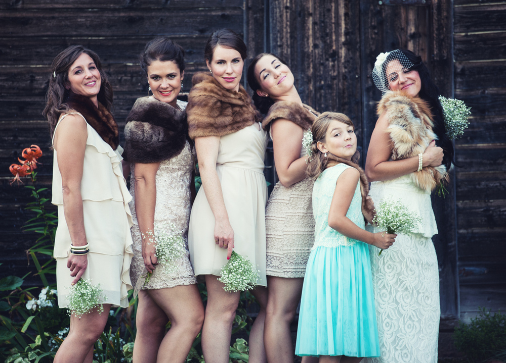 This wedding had everyone. Rain, clouds and eventually a lot of sun and warm temperatures. For this particular shot, I got the girls to stand against one of the old sheds which was in the shade. Shade is a photographers best friend. It creates natural even light.