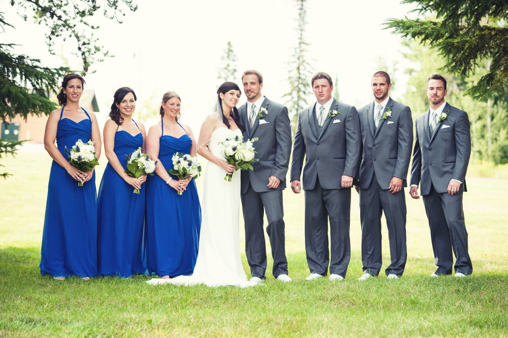 With only 8 total people, this wasn't the largest wedding party I ever shot but it was important to find a large enough area for them to fit. Another bright sunny day with no shade, I moved them to open area with trees for shade. Not only was it cooler for everyone but it allowed for much better lighting.