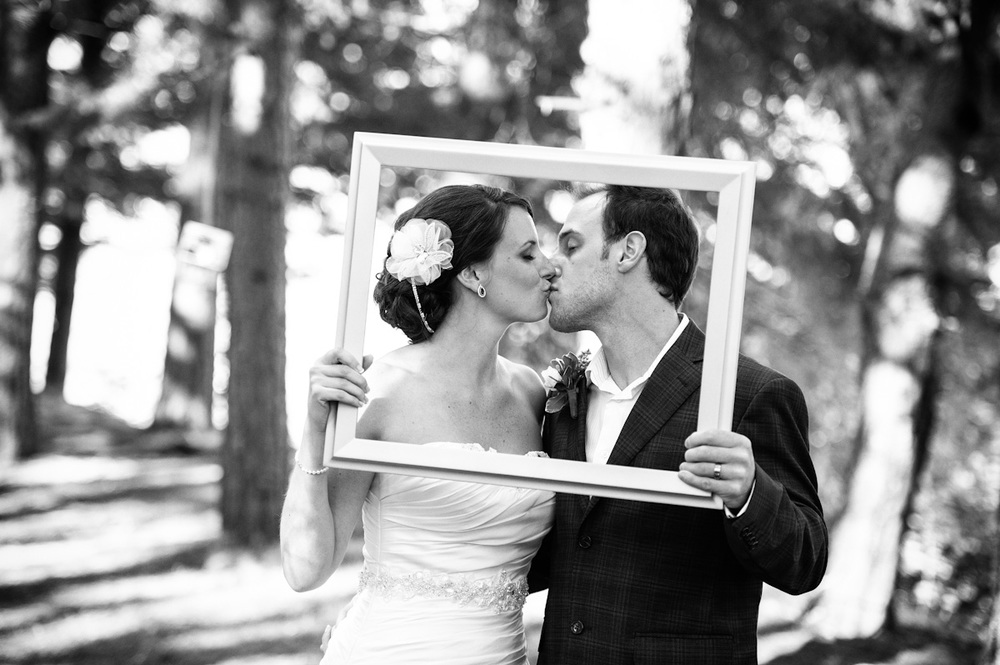 This was a fun photo done right at the end of the wedding. The picture frame tied in to the scattered frames hanging down from the trees.