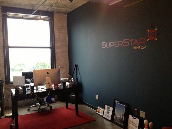 Thanks to Michael with SuperStarPR for sharing a picture of his logo that we made into a wall decal.