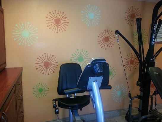 This work out room is bursting with color after Rick and Ellen added our Atomic Stars wall decals.