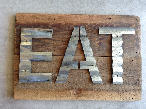 Handmade sign using vintage, reclaimed barn wood with naturally aged patina corrugated metal letters.