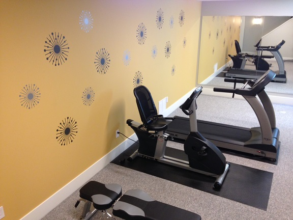 Who wouldn't want to work out here?  Mary and Rich chose our Atomic Stars wall decals to compliment their Mid-Century Modern decor.  Thank you for sharing.