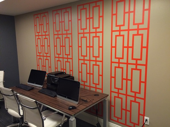 Thank you to Maria for sharing this photo of the Business Center of Four Winds Nola in New Orleans using our Geometric Screens wall decals. (shown here in orange)